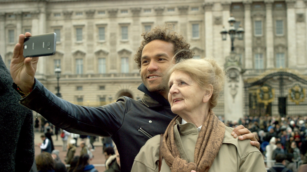 Sian-Pierre Regis and his mother Rebecca Danigelis at Buckingham Palace. As seen in Duty Free, directed by Sian-Pierre Regis. Photo credit: Joey Dwyer. Image courtesy of Duty Free Film