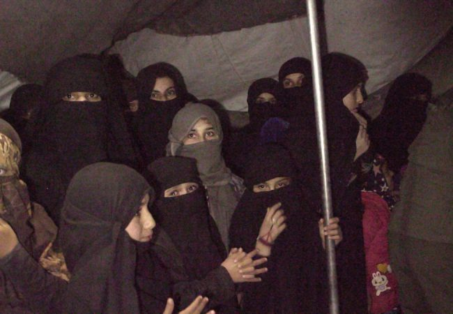 A group of women and girls are rounded up in order to find one of the Sabaya (sex slaves) held by ISIS in Syria's Al - Hol camp, the most dangerous camp in the Middle East. As seen in Sabaya, directed by Hogir Hirori. Image courtesy of MTV Documentary Films.